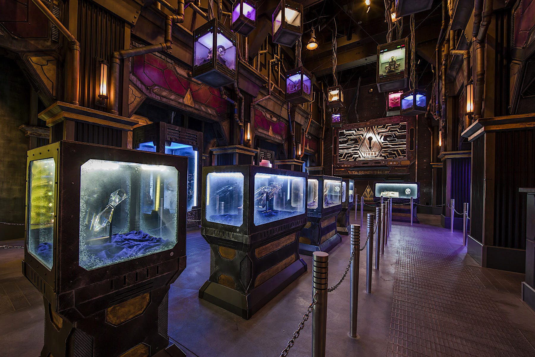 Artifacts from the movie Guardians of the Galaxy are stored behind glass cases in a set which resembles the film