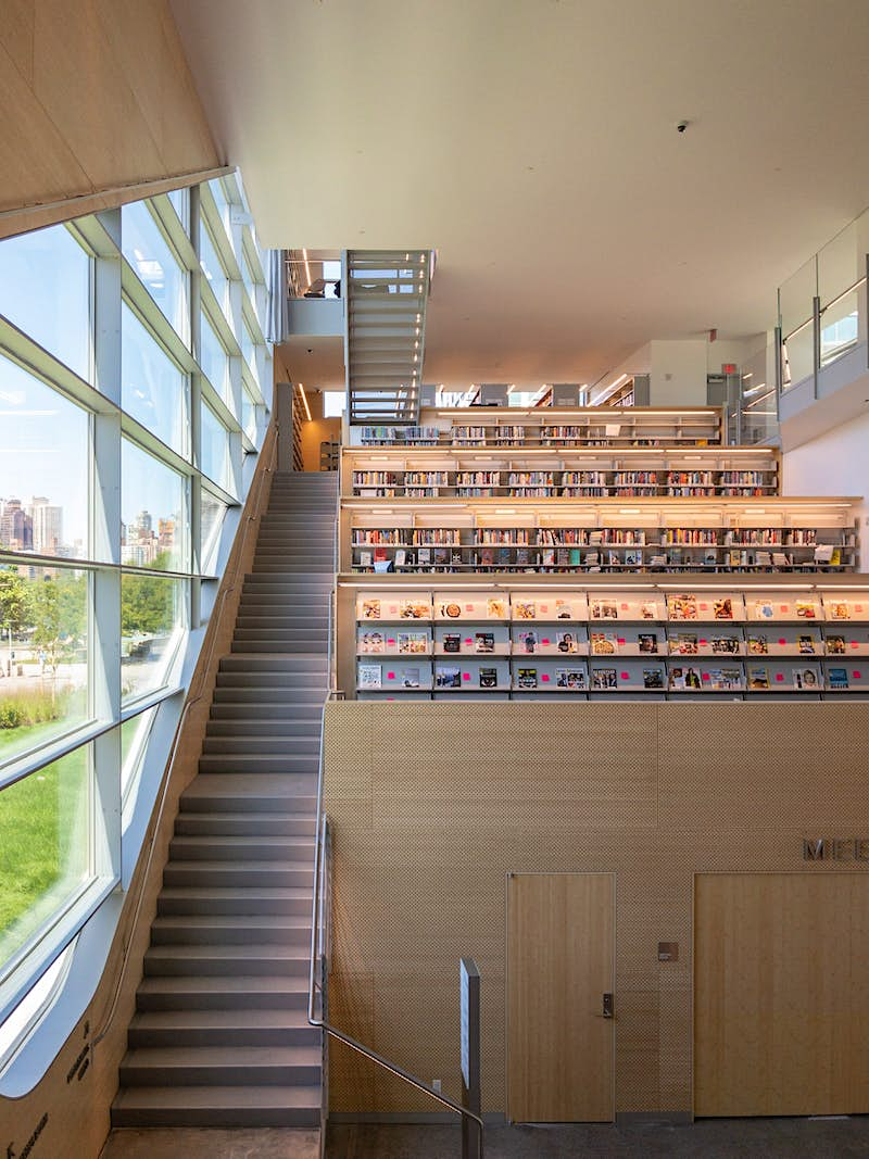 The exterior of Hunters Point library with many books on display