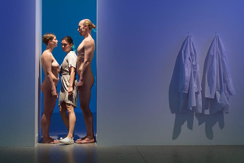 Visitors will move past naked performers at a London exhibition in 2020