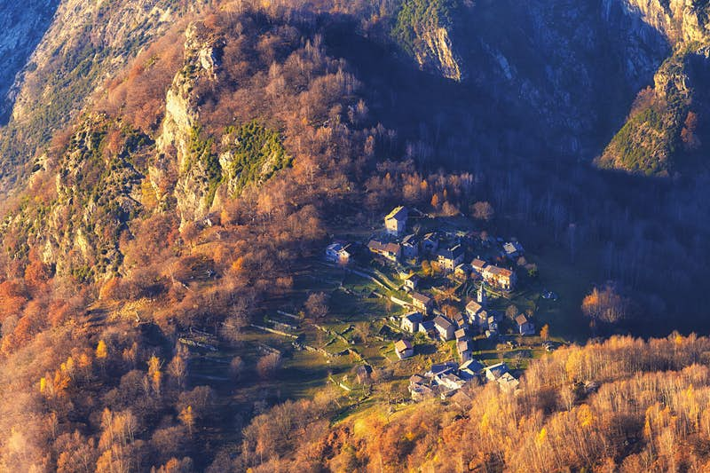 The mountain village of San Giorgio in northern Italy is seen from above as it is awash in autumn colours