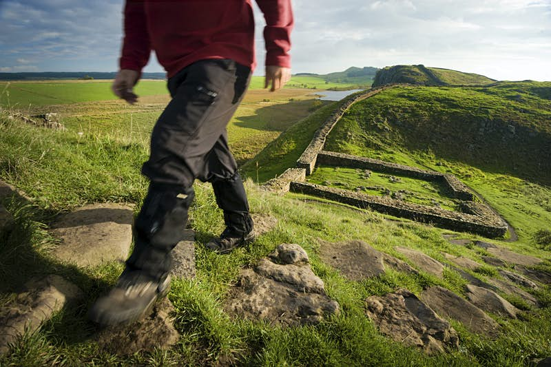Hiker walking Hadrian's Wall trail at Milecastle 39, also known as Castle Nick.