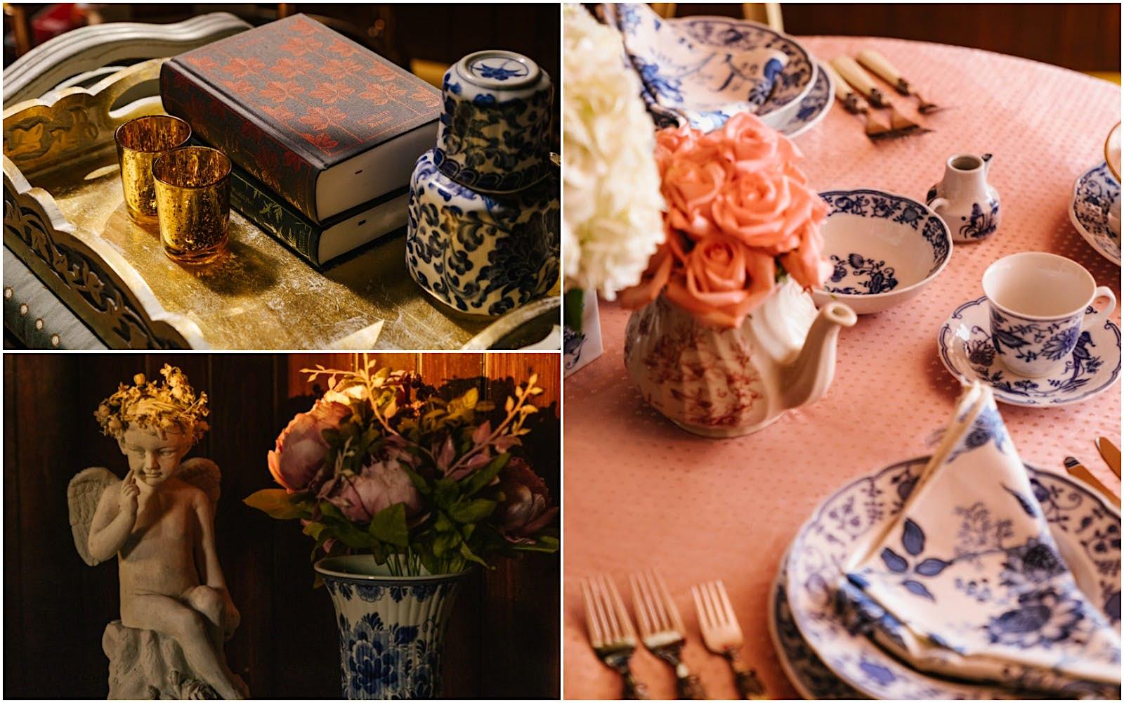 Uma mesa está vestida com toalha de mesa rosa e xícaras de porcelana