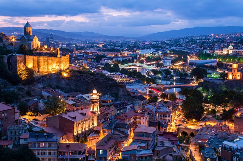 The Old Town and Narikala Fortress at dusk in Tbilisi
