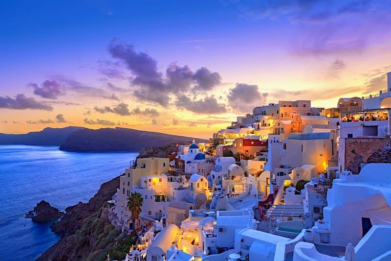 The village of Santorini glowing at sunset.