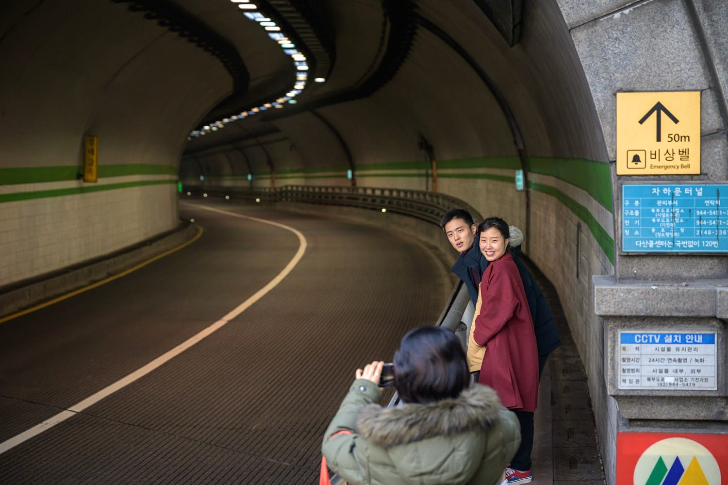A couple pose for a photo at a tunnel featured in South Korean film Parasite