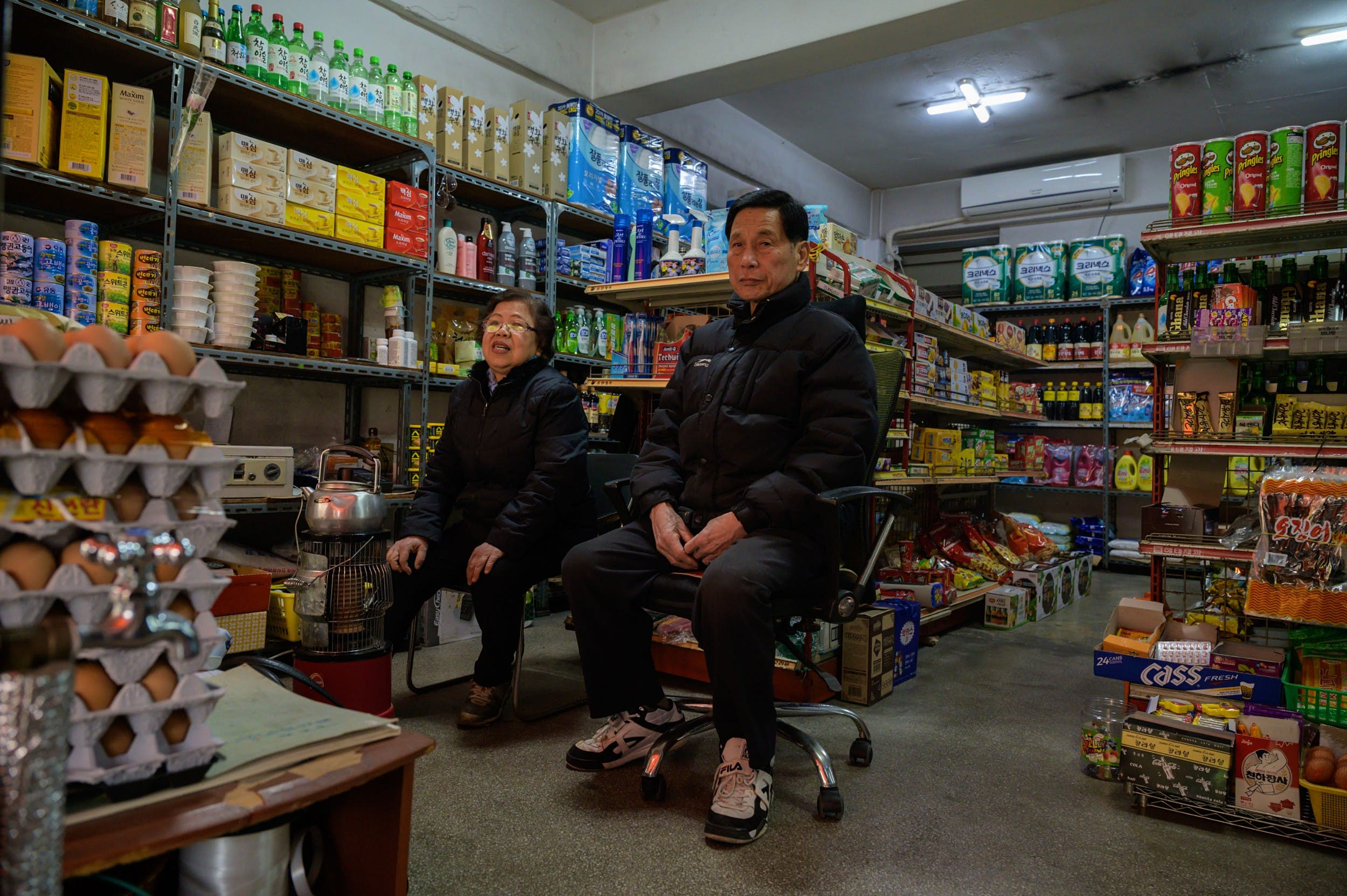 Owner Kim Kyung-soon sits in the Pig Rice Supermarket in Seoul