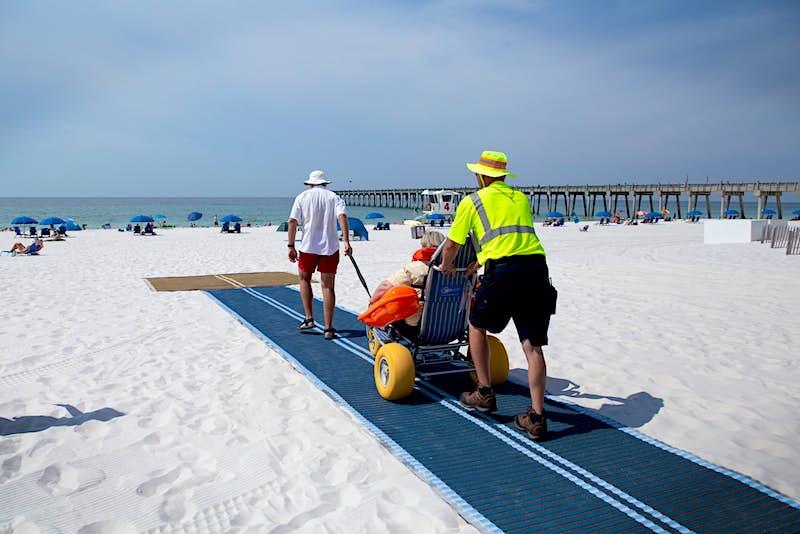 People testing the Mobi-Mat on a beach inn Pensacola Beach in Florida