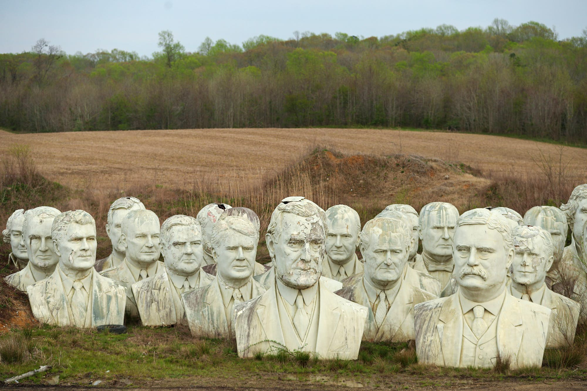 Twent foot busts of former US Presidents' heads at Croaker. Teddy Roosevelt is visible centre-right.