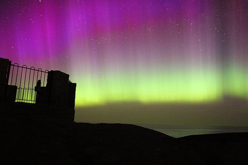 The northern lights behind Iceland's Sandrock Holiday Hostel