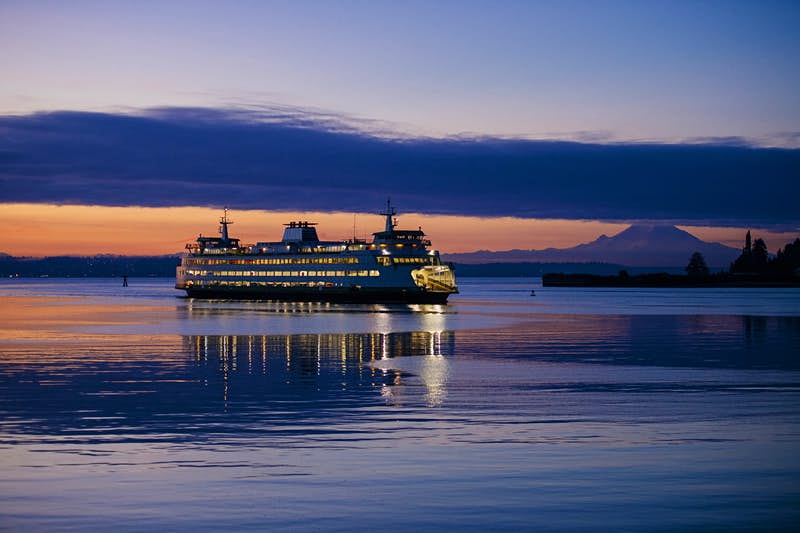 A ferry slips through Puget Sound off the coast of Seattle; Seattle Waterfront Activities