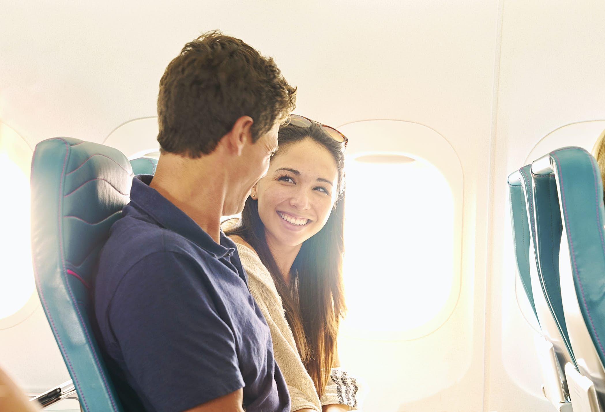 Smiling couple on plane