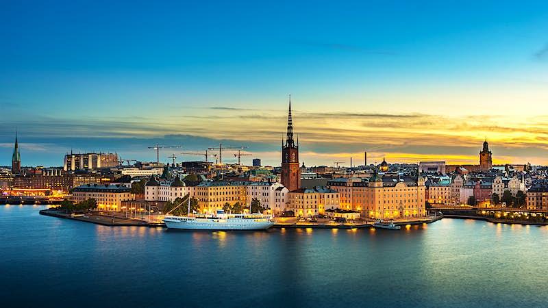 Sunset over Riddarholmen chruch in old town Stockholm city, Sweden -.jpg