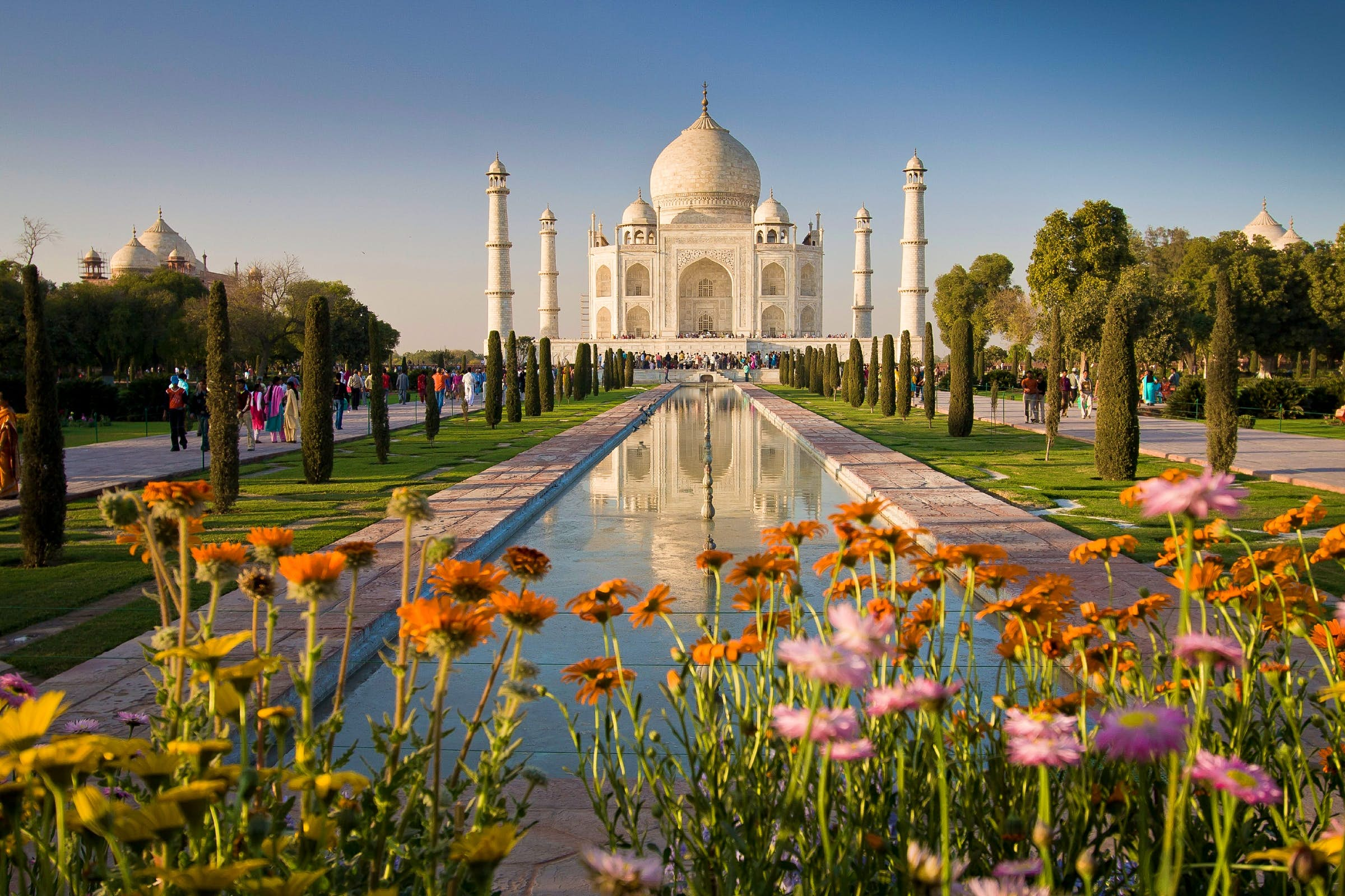India's Taj Mahal with flowers in the foreground.