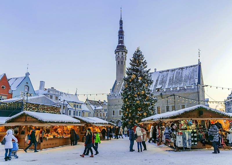 A snow covered Christmas Market in Tallinn's town hall square