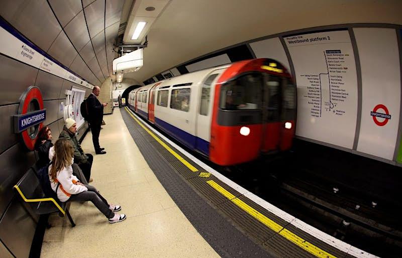 A London Underground train arrives in Knightsbridge station