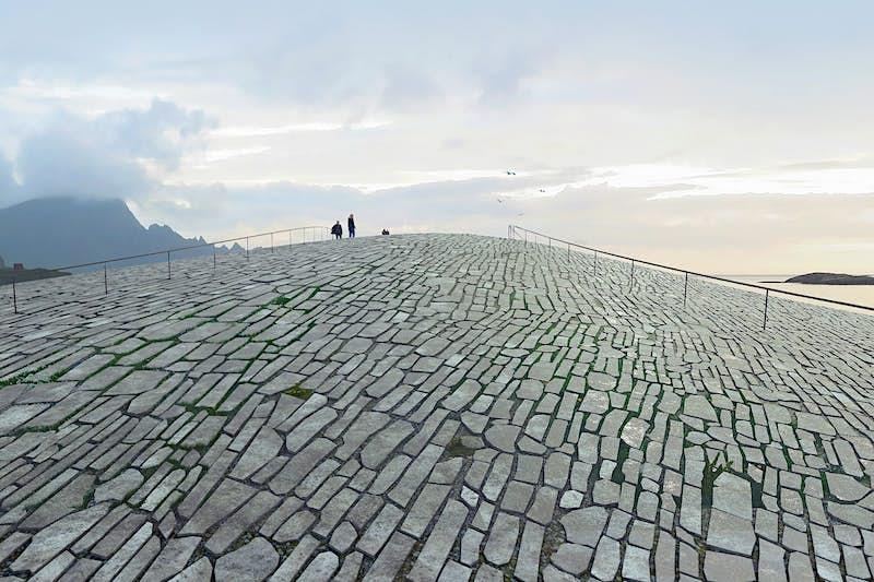 O telhado curvo do edifício será coberto de pedras © Rendering by MIR