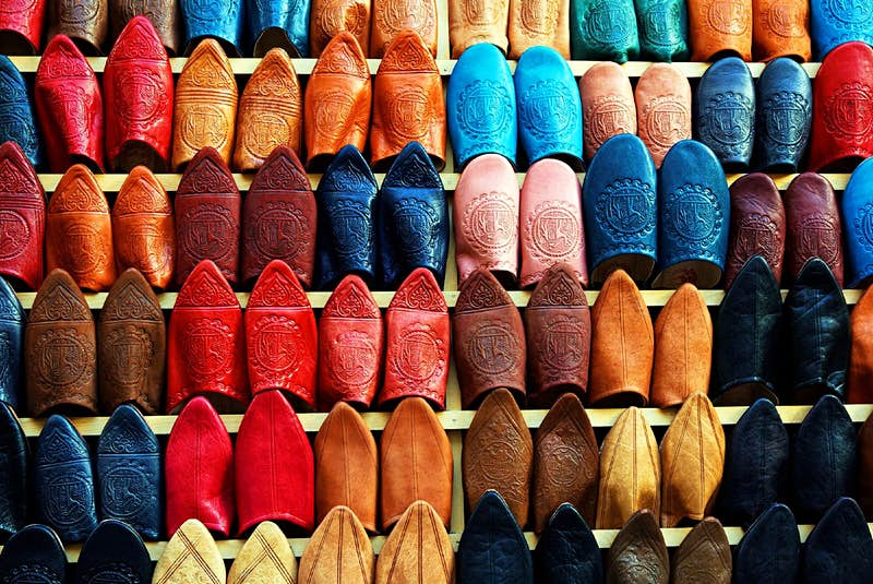 Dozens of pairs of leather slippers in all different colours on display in Marrakesh.