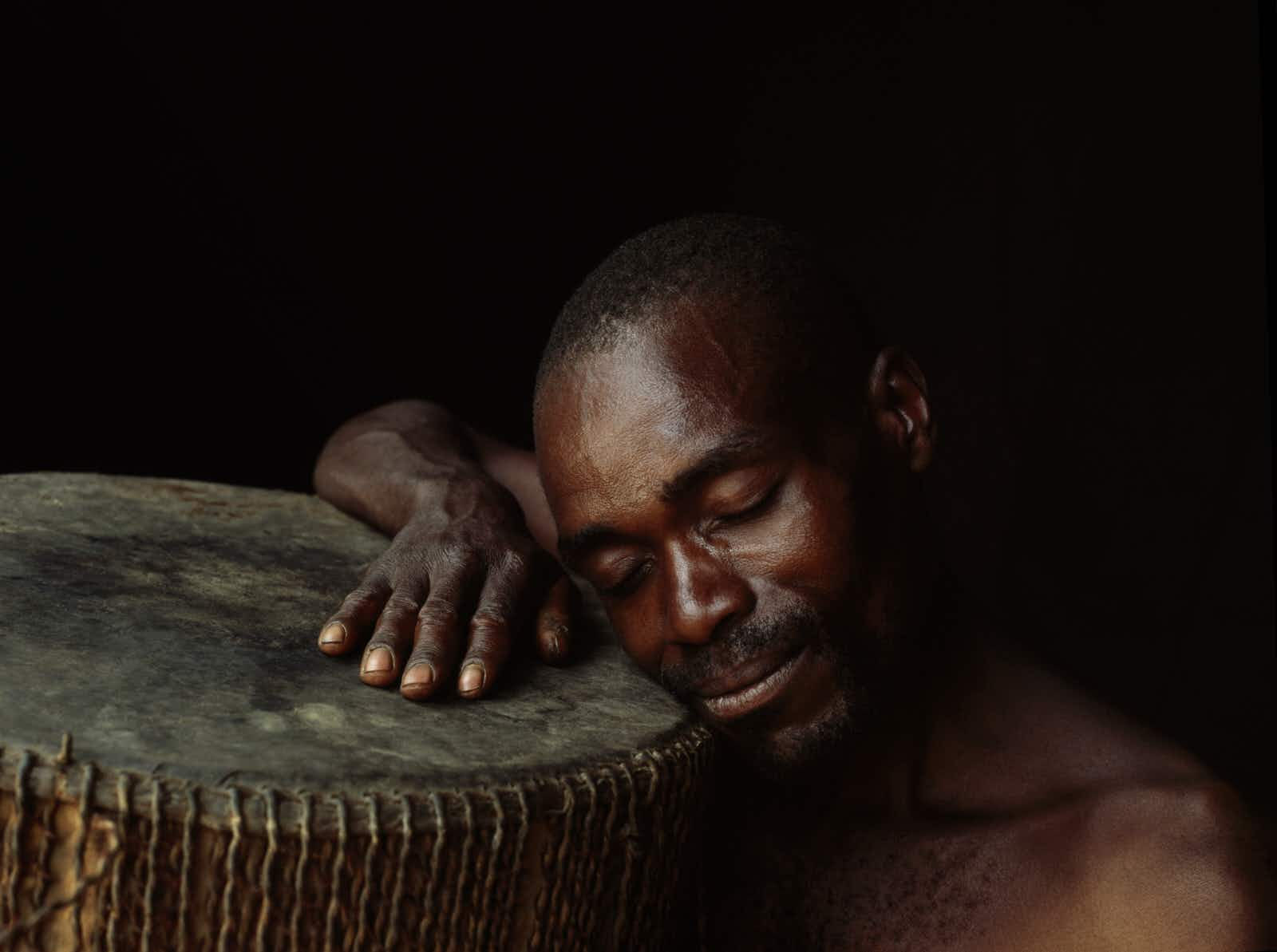 A Batwa drummer happily lost in his dreams © Harry Hook / Getty Images