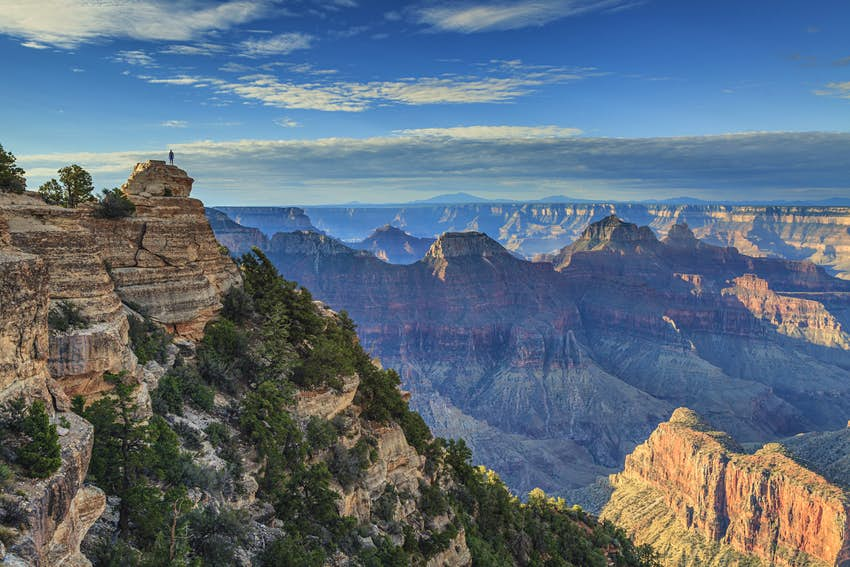 A hiker stands above the Grand Canyon's North Rim