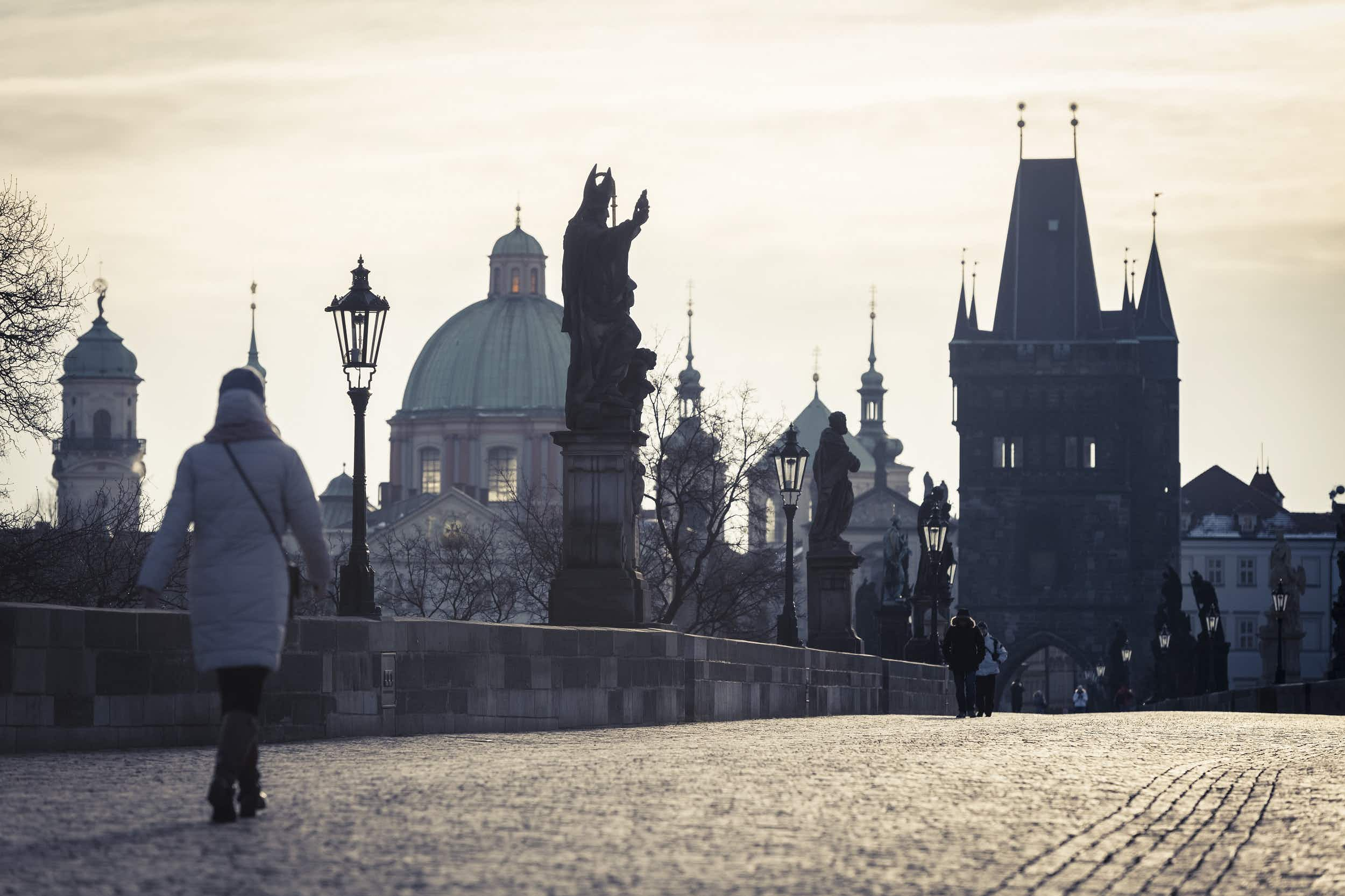 Charles Bridge lined with baroque statues, all enjoyed for free © Jonathan Stokes / Lonely Planet