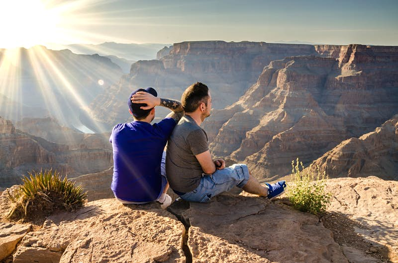 A young male couple looking into the Grand Canyon in Arizona, USA.