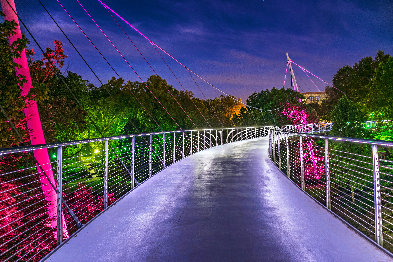 An illuminated footbridge at night