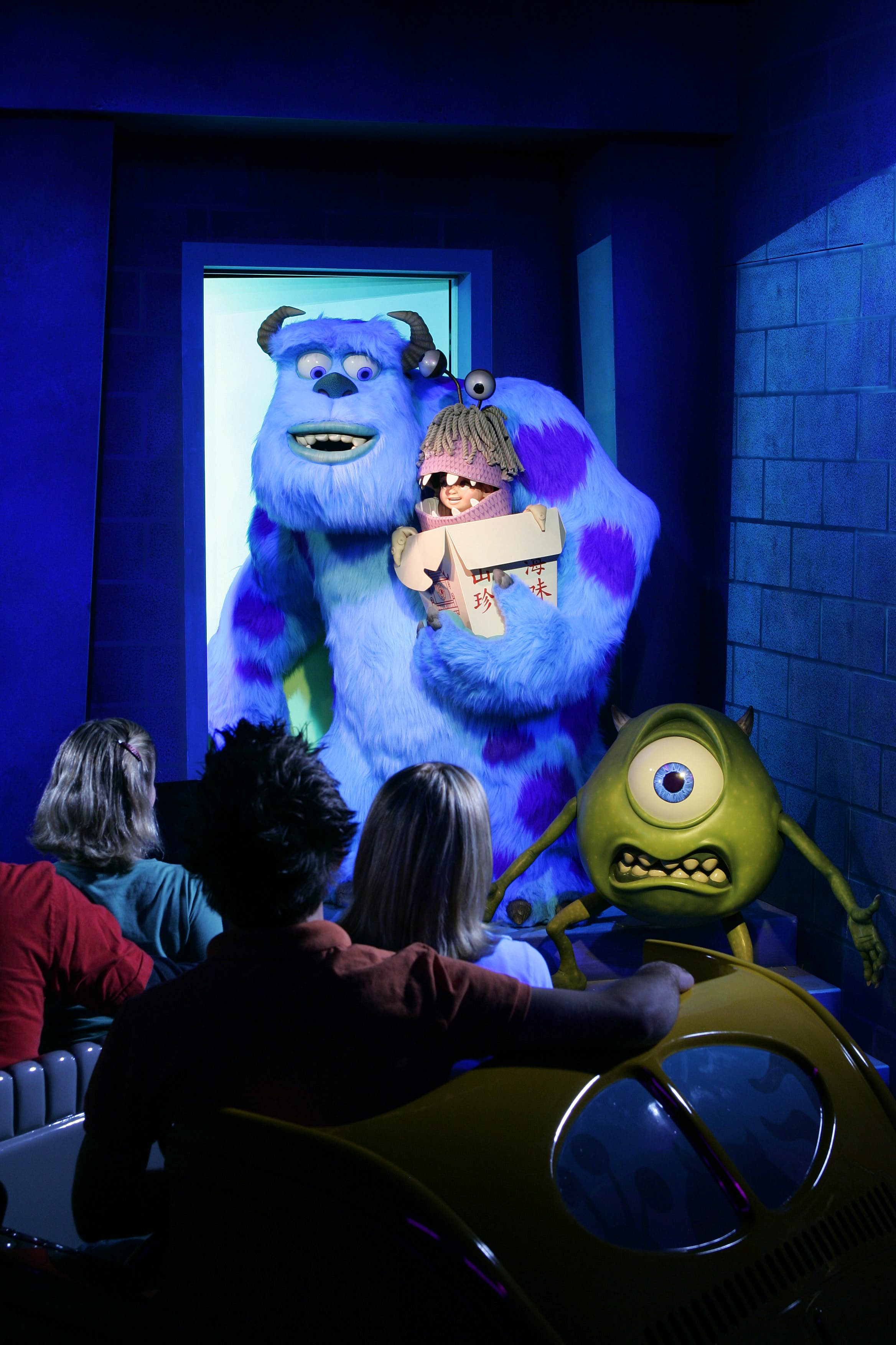 Animatronics of Mike, Sulley and Boo with guests in the foreground looking up at them