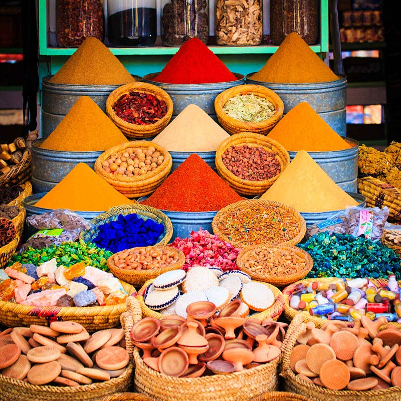 Spices and herbs arranged in colourful piles on display