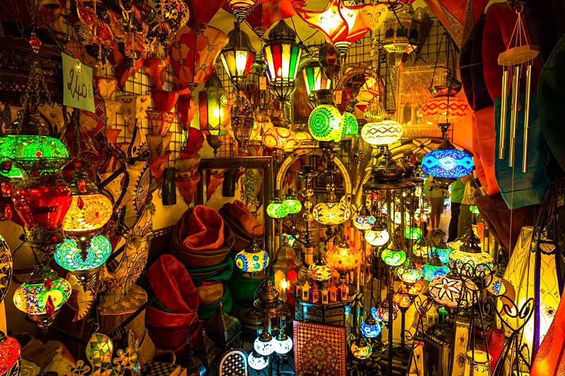 Dozens of colourful lamps glowing in a stall
