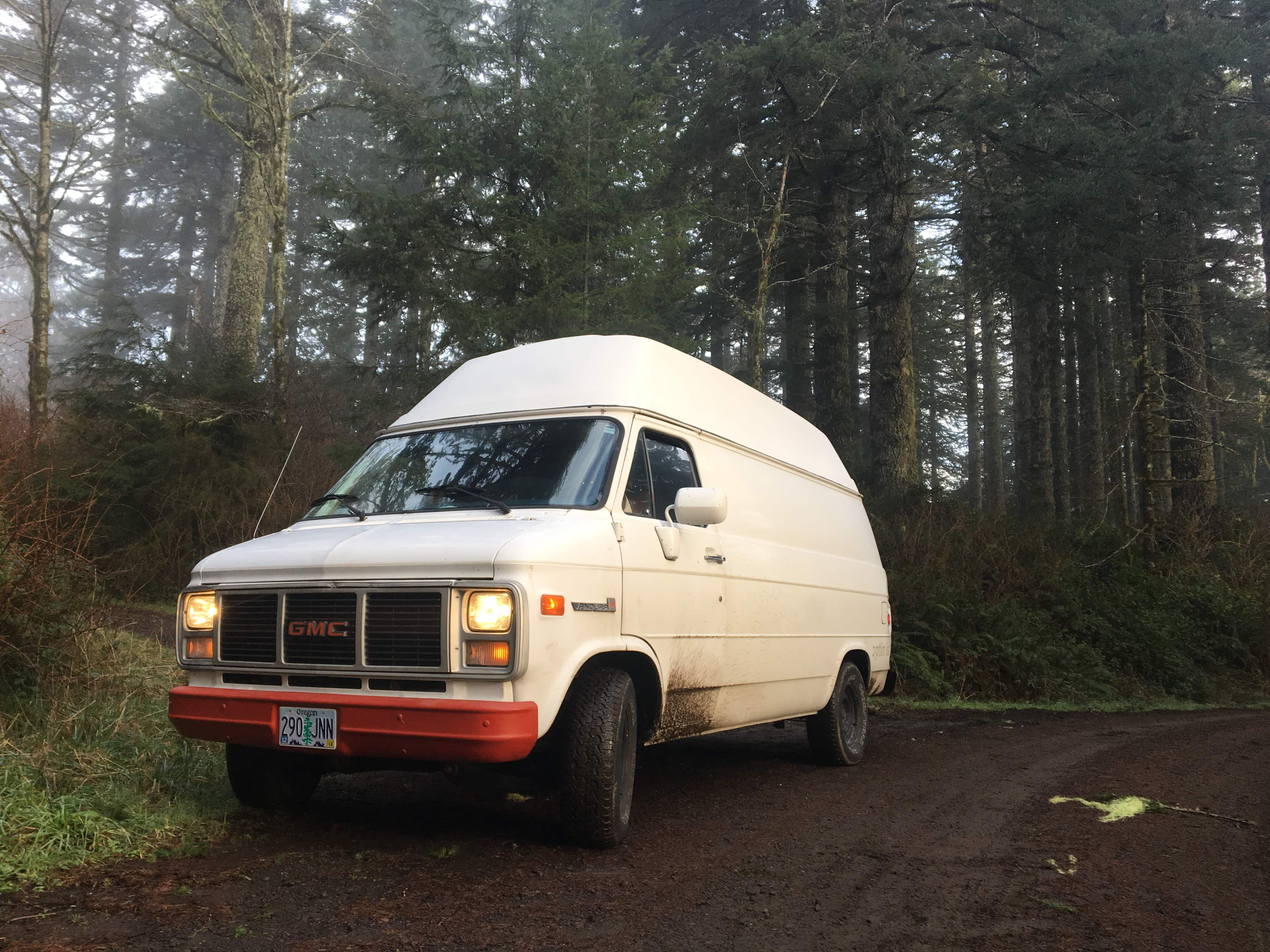 Britany Robinson's thirty year old GMC van is towed from a forest service road in snow-blanketed Montana. © Britany Robinson / Lonely Planet