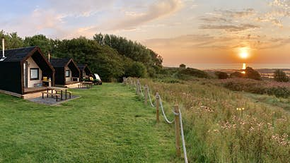 Go off-the-grid with these English seaside huts