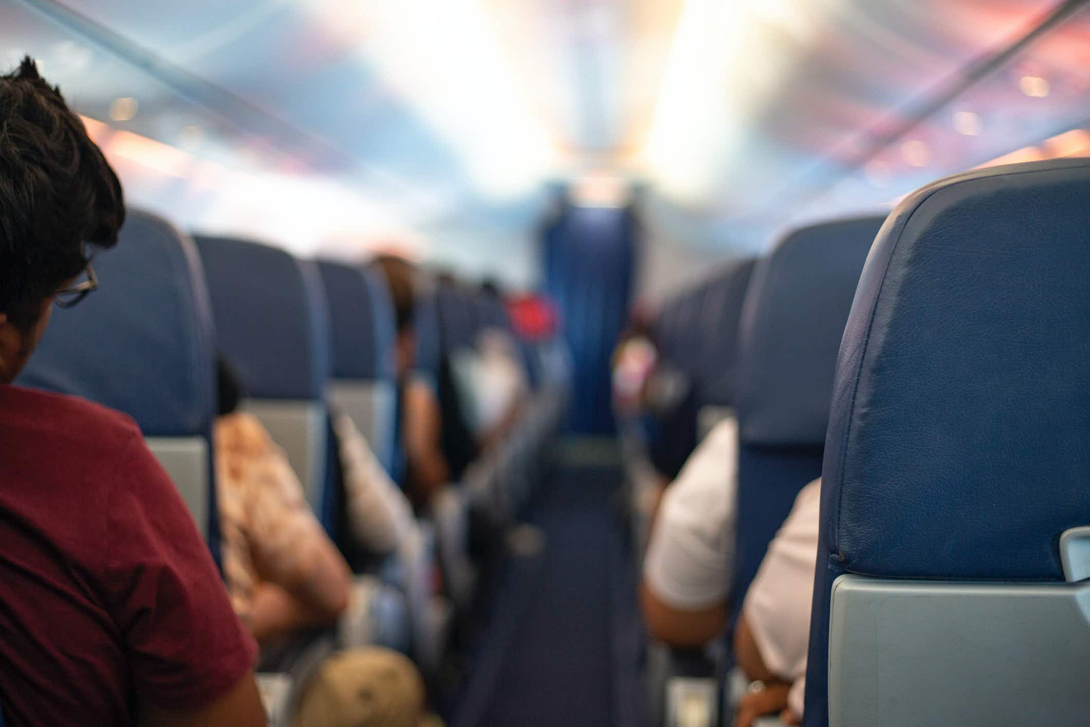What happens if someone on your flight is diagnosed with COVID-19?