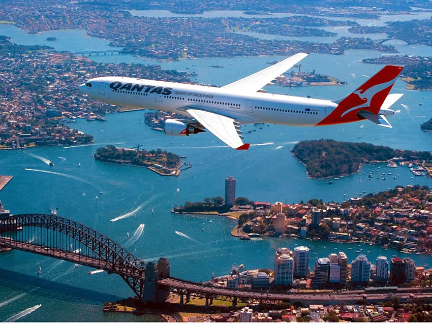A Qantas plane flying over Sydney
