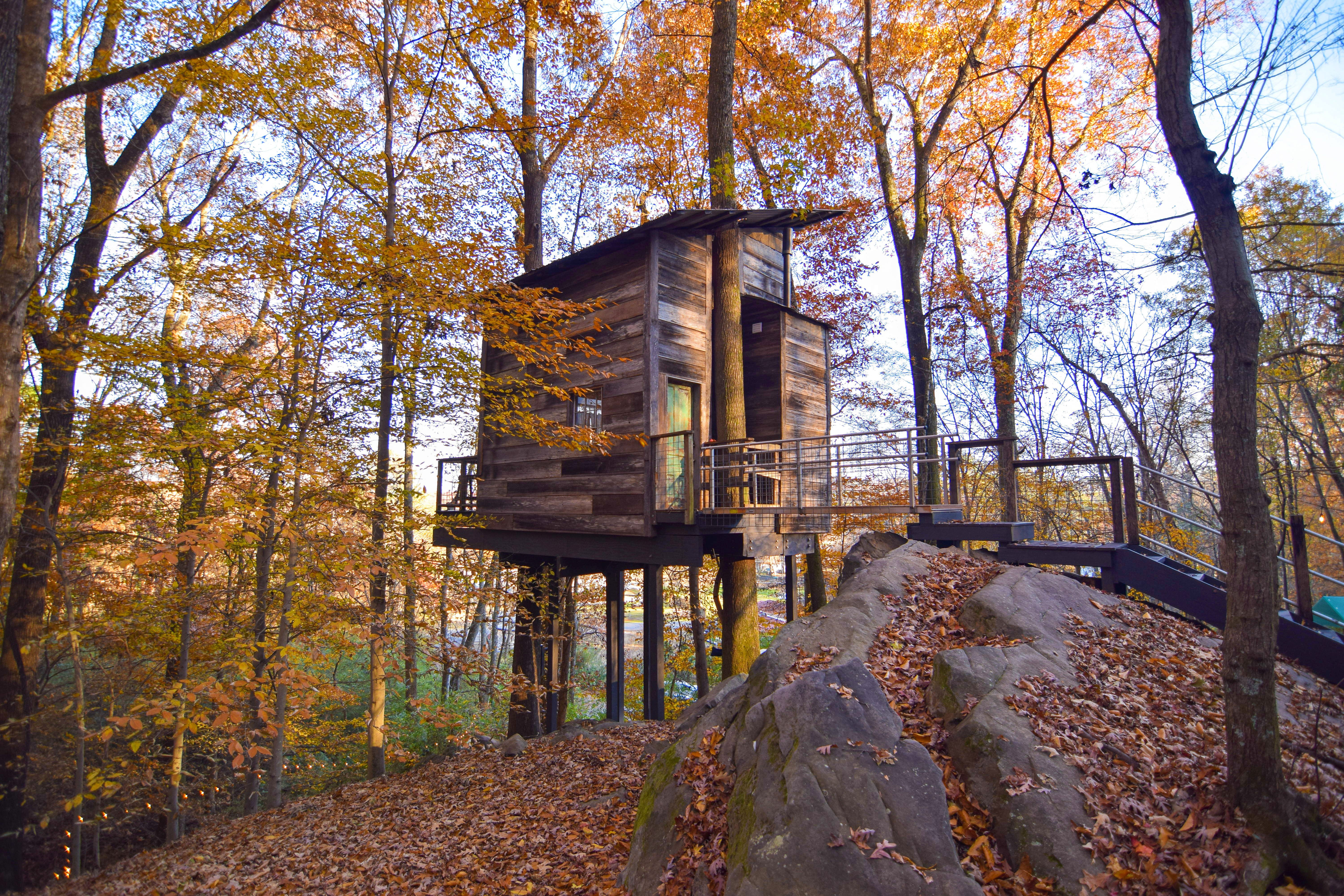 The warm rustic wood exterior of one of the Treetop Hideaways tree houses in Chattanooga, Tennessee