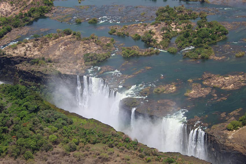 An aerial photo taken by the Zambezi Helicopter Company on December 9th, 2019 shows several columns of white water spilling over Victoria Falls in Zimbabwe