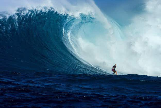 One-armed surfing legend rides Hawaii's monster wave
