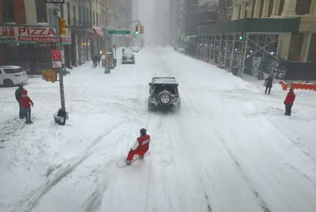 Snowboarder cruises New York City streets during blizzard