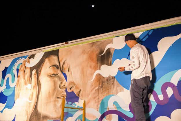 Street artists turn Hawaiian airport vehicles into works of art
