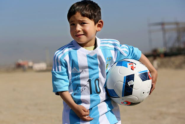 watch c3332 68f63 Lionel Messi sends real Argentina football kit to Afghan boy ...