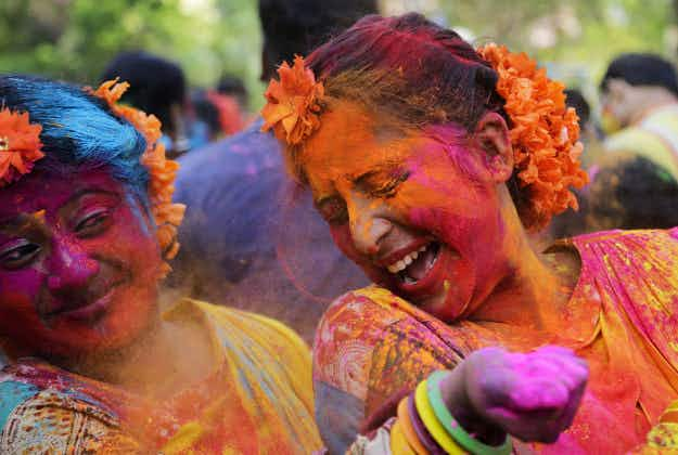 Brilliant colours brighten up streets, clothes and faces as people celebrate the Hindu festival Holi