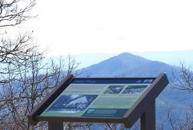 A sign for the Cradle of Forestry, located on the Blue Ridge Parkway at milepost 411.