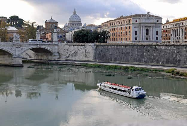 Artwork showing figures from Rome's history etched into the banks of the river Tiber
