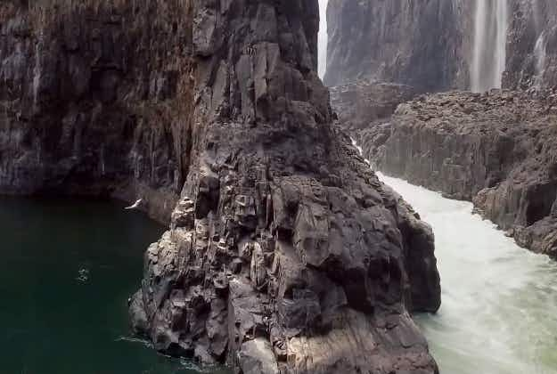 Watch two cliff divers leap almost 100 feet from Victoria Falls in southern Africa