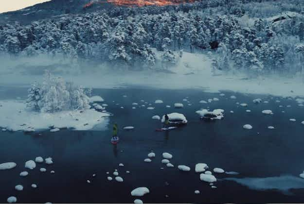 Norway's winter landscape shines in footage of stand up paddle boarding adventure