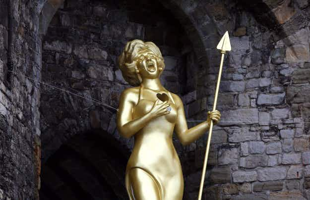 Giant, golden Shirley Bassey statue erected on Welsh castle walls