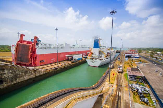Celebrations greet first massive ship to pass through expanded Panama Canal