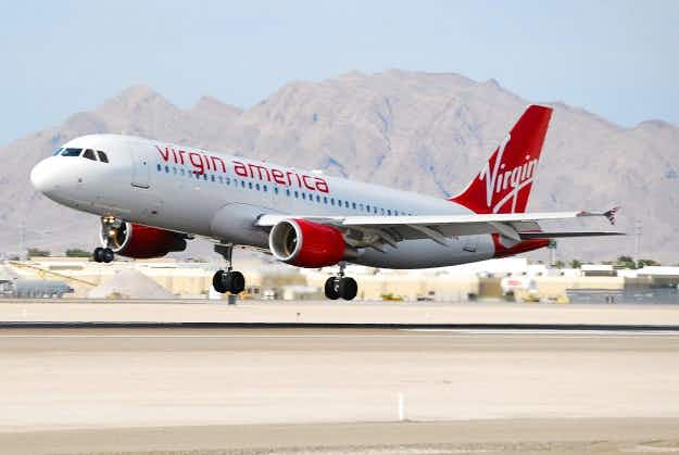 Virgin America named USA's top performing airline, but it may soon be owned by the airline in 5th place