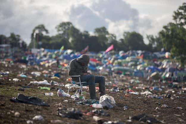 Happy campers: Glastonbury revellers depart a soggy festival after a weekend of mud and music