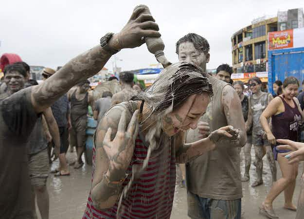 Getting down and dirty in South Korea: pop singer Psy kicks off Boryeong Mud Festival
