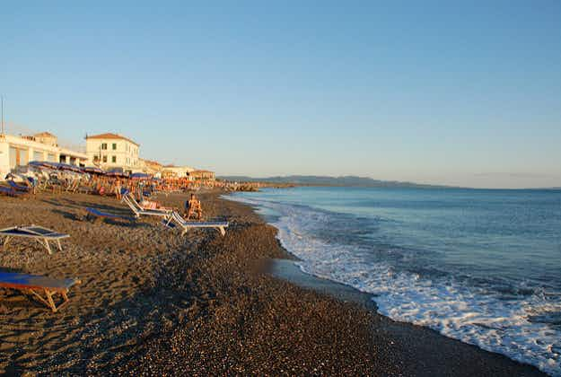 Italian coast guard begins crackdown on tourists leaving towels on beaches overnight